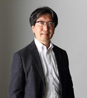 友岡 賢二 氏
